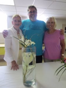 Chris Branham of Christopher's Creations, Middlesboro, with Club Hostesses Gypsie Bellar and Barbara Evans at the conclusion of a floral design program presented by Chris.The beautiful arrangements were given as door prizes.
