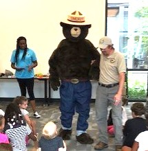 Smokey the Bear at library